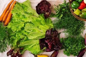 Assortment of vegetables and green herbs. Market. Flat lay. Top view
